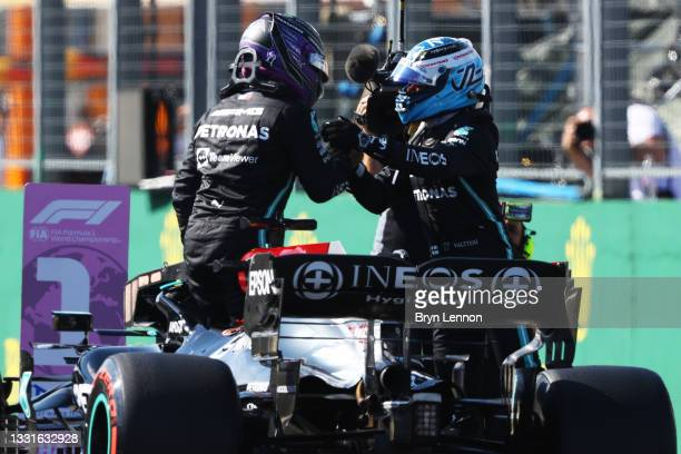 Pole position qualifier Lewis Hamilton of Great Britain and Mercedes GP and second place qualifier Valtteri Bottas of Finland and Mercedes GP...