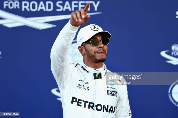 Pole position qualifier Lewis Hamilton of Great Britain and Mercedes GP celebrates in parc ferme during qualifying for the Azerbaijan Formula One...