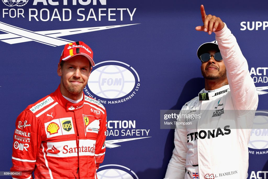 Pole position qualifier Lewis Hamilton of Great Britain and Mercedes GP celebrates in parc ferme with second placed qualifier Sebastian Vettel of Germany and Ferrari during qualifying for the Formula One Grand Prix of Belgium at Circuit de Spa-Francorchamps on August 26, 2017 in Spa, Belgium.