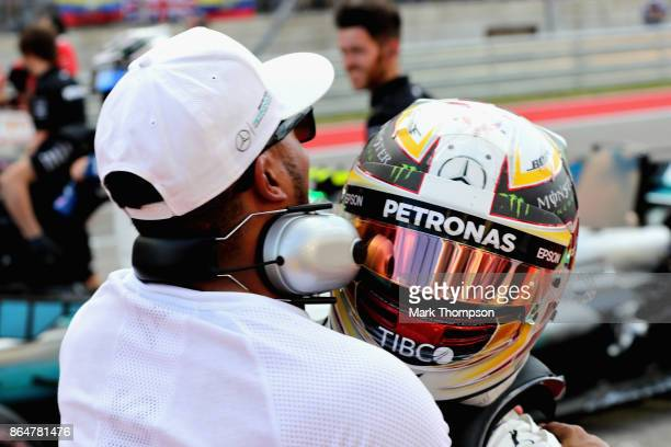 Pole position qualifier Lewis Hamilton of Great Britain and Mercedes GP celebrates with brother Nicholas in parc ferme during qualifying for the...