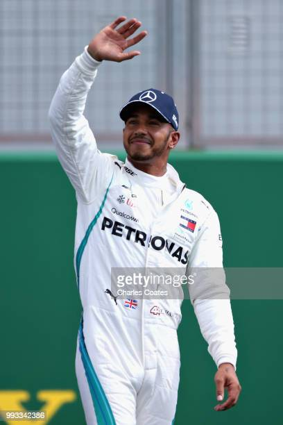 Pole position qualifier Lewis Hamilton of Great Britain and Mercedes celebrates in parc ferme during qualifying for the Formula One Grand Prix of...