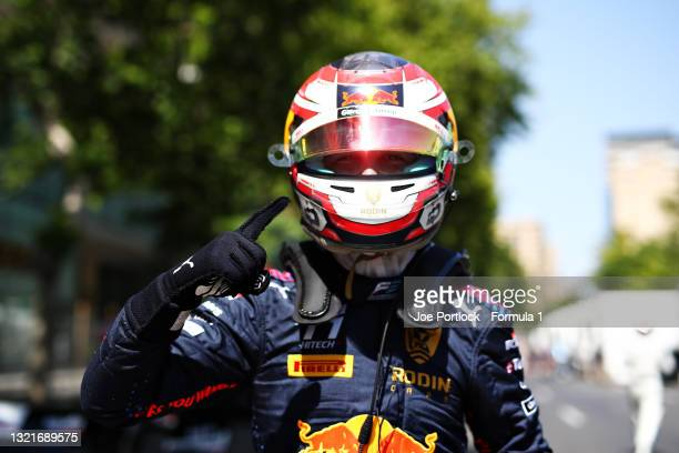 Pole position qualifier Liam Lawson of New Zealand and Hitech Grand Prix celebrates in parc ferme during qualifying ahead of Round 3:Baku of the...