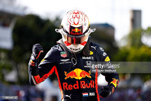 Pole position qualifier Max Verstappen of Netherlands and Red Bull Racing celebrates in parc ferme during qualifying for the F1 Grand Prix of Brazil...