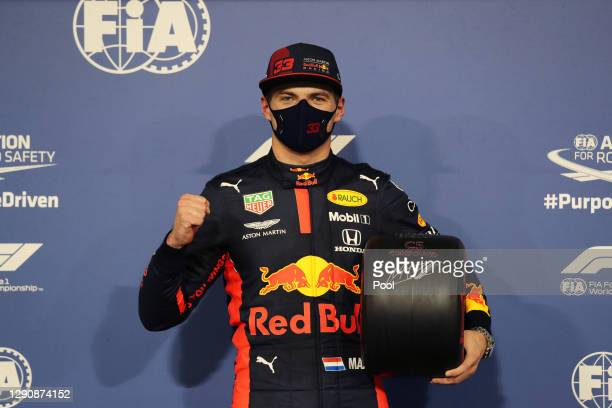 Pole position qualifier Max Verstappen of Netherlands and Red Bull Racing celebrates with his pole position award in parc ferme during qualifying...