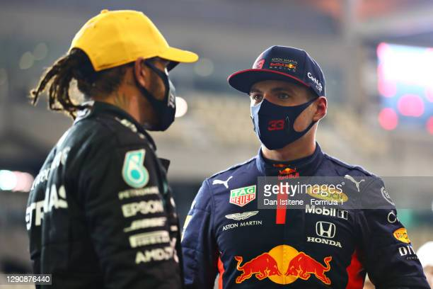 Pole position qualifier Max Verstappen of Netherlands and Red Bull Racing speaks with third placed qualifier Lewis Hamilton of Great Britain and...
