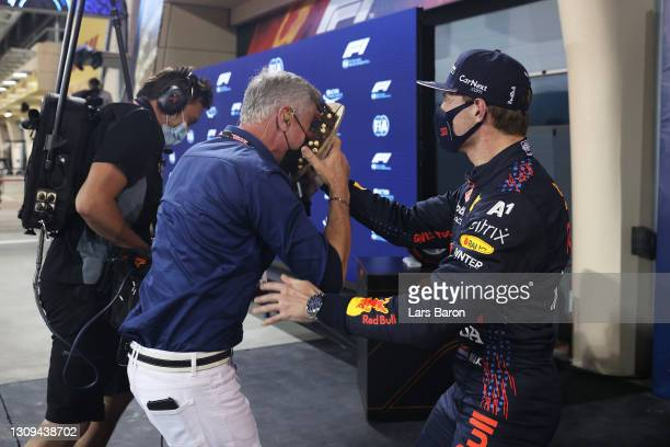 Pole position qualifier Max Verstappen of Netherlands and Red Bull Racing puts a cake in the face of TV presenter and former racing driver David...