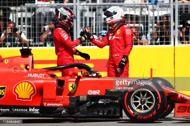 Pole position qualifier Sebastian Vettel of Germany and Ferrari and third place qualfieri Charles Leclerc of Monaco and Ferrari shake hands in parc...