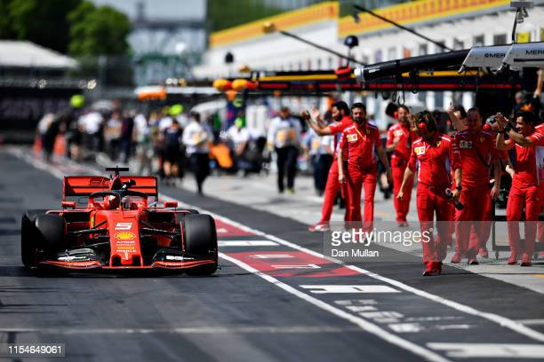 Pole position qualifier Sebastian Vettel of Germany and Ferrari celebrates as he drives down the pitlane during qualifying for the F1 Grand Prix of...
