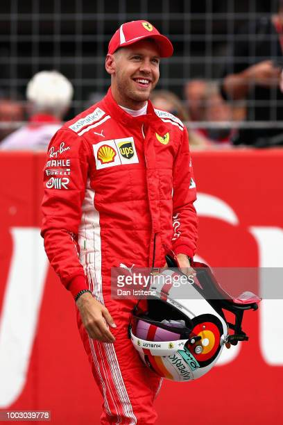 Pole position qualifier Sebastian Vettel of Germany and Ferrari celebrates in parc ferme during qualifying for the Formula One Grand Prix of Germany...