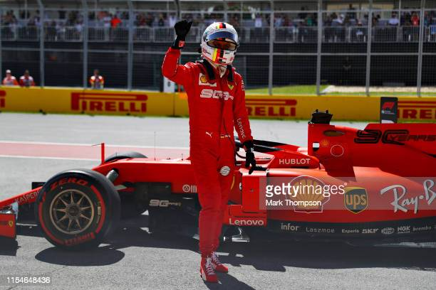 Pole position qualifier Sebastian Vettel of Germany and Ferrari celebrates in parc ferme during qualifying for the F1 Grand Prix of Canada at Circuit...