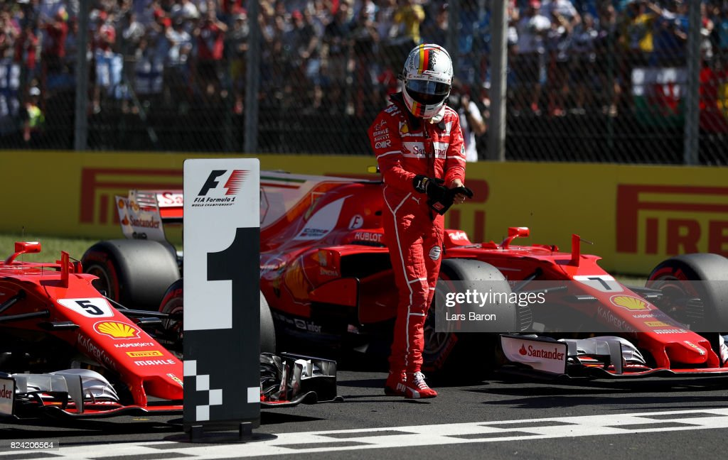 Pole position qualifier Sebastian Vettel of Germany and Ferrari in parc ferme during qualifying for the Formula One Grand Prix of Hungary at Hungaroring on July 29, 2017 in Budapest, Hungary.