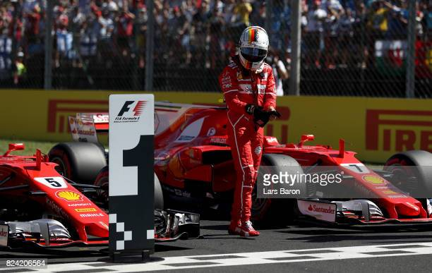 Pole position qualifier Sebastian Vettel of Germany and Ferrari in parc ferme during qualifying for the Formula One Grand Prix of Hungary at...