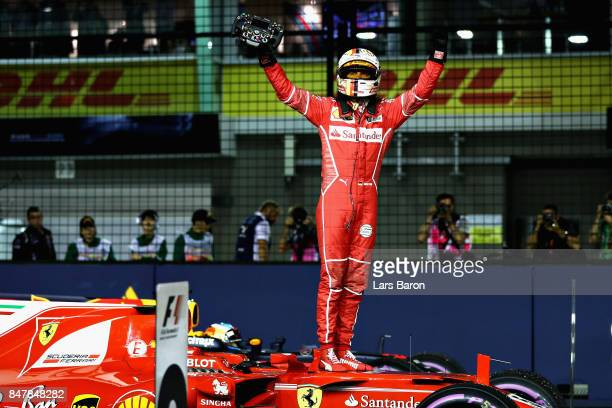 Pole position qualifier Sebastian Vettel of Germany and Ferrari celebrates in parc ferme during qualifying for the Formula One Grand Prix of...