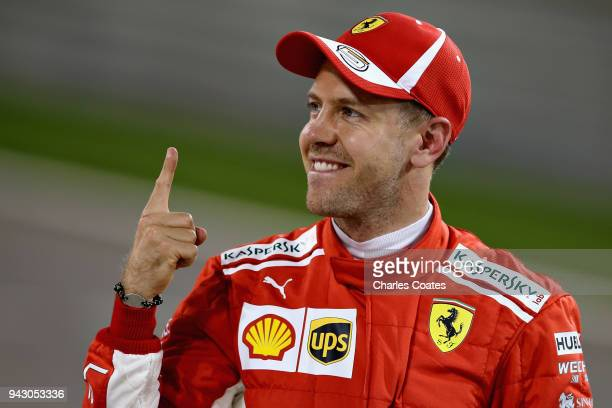 Pole position qualifier Sebastian Vettel of Germany and Ferrari celebrates in parc ferme during qualifying for the Bahrain Formula One Grand Prix at...