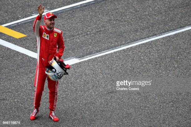 Pole position qualifier Sebastian Vettel of Germany and Ferrari celebrates in parc ferme during qualifying for the Formula One Grand Prix of China at...