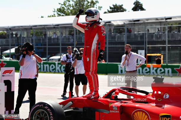 Pole position qualifier Sebastian Vettel of Germany and Ferrari celebrates in parc ferme during qualifying for the Canadian Formula One Grand Prix at...