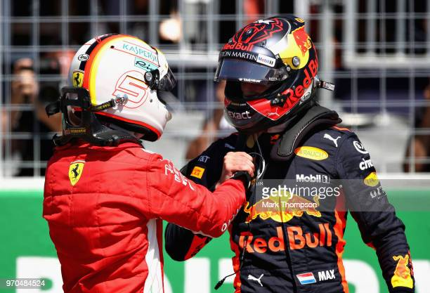 Pole position qualifier Sebastian Vettel of Germany and Ferrari shakes hands with third place qualifier Max Verstappen of Netherlands and Red Bull...