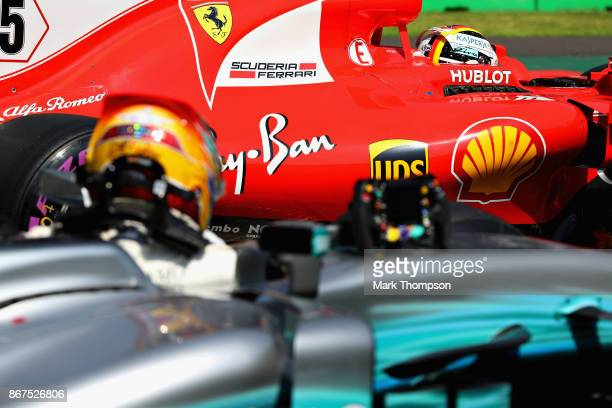 Pole position qualifier Sebastian Vettel of Germany and Ferrari pulls into parc ferme ahead of third place qualifier Lewis Hamilton of Great Britain...