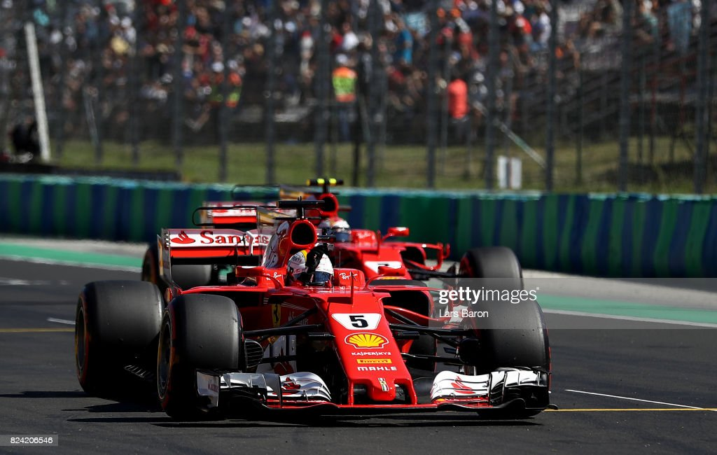 Pole position qualifier Sebastian Vettel of Germany and Ferrari waves to the crowd from parc ferme during qualifying for the Formula One Grand Prix of Hungary at Hungaroring on July 29, 2017 in Budapest, Hungary.