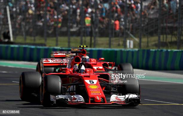 Pole position qualifier Sebastian Vettel of Germany and Ferrari waves to the crowd from parc ferme during qualifying for the Formula One Grand Prix...