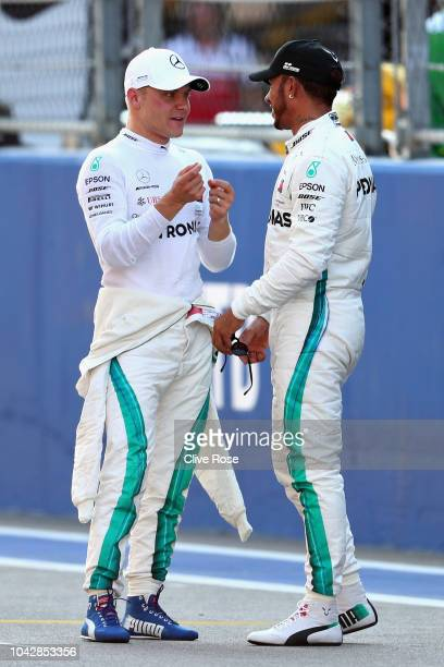 Pole position qualifier Valtteri Bottas of Finland and Mercedes GP talks with second place qualifier Lewis Hamilton of Great Britain and Mercedes GP...