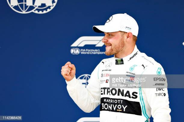 Pole position qualifier Valtteri Bottas of Finland and Mercedes GP celebrates in parc ferme during qualifying for the F1 Grand Prix of China at...