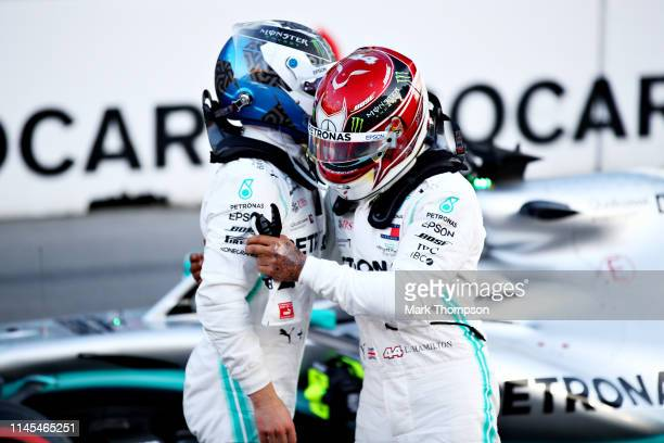Pole position qualifier Valtteri Bottas of Finland and Mercedes GP celebrates with second place qualifier Lewis Hamilton of Great Britain and...