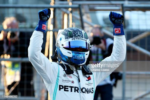 Pole position qualifier Valtteri Bottas of Finland and Mercedes GP celebrates in parc ferme during qualifying for the F1 Grand Prix of Azerbaijan at...