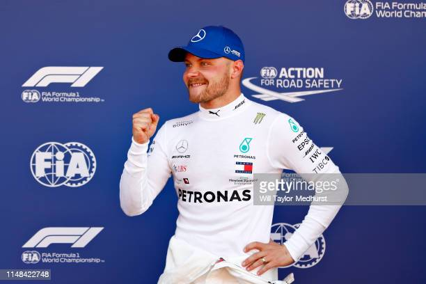 Pole position qualifier Valtteri Bottas of Finland and Mercedes GP celebrates in parc ferme during qualifying for the F1 Grand Prix of Spain at...