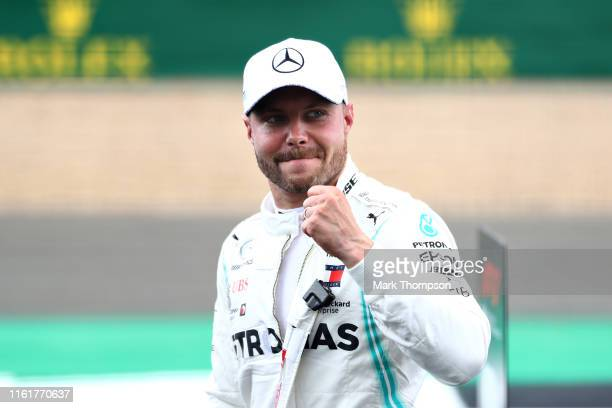 Pole position qualifier Valtteri Bottas of Finland and Mercedes GP celebrates in parc ferme during qualifying for the F1 Grand Prix of Great Britain...