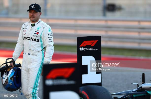 Pole position qualifier Valtteri Bottas of Finland and Mercedes GP celebrates in parc ferme during qualifying for the F1 Grand Prix of USA at Circuit...