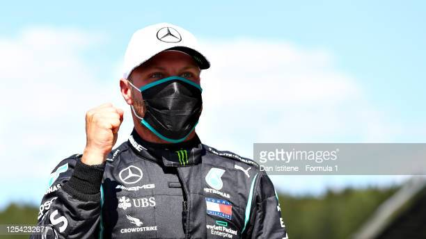 Pole position qualifier Valtteri Bottas of Finland and Mercedes GP celebrates in parc ferme during qualifying for the Formula One Grand Prix of...