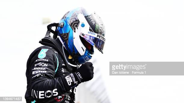 Pole position qualifier Valtteri Bottas of Finland and Mercedes GP celebrates in parc ferme during qualifying for the F1 70th Anniversary Grand Prix...