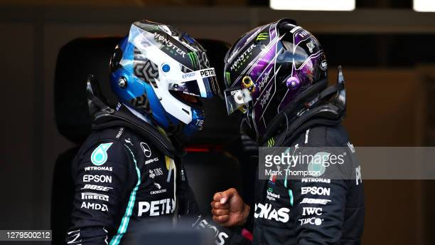 Pole position qualifier Valtteri Bottas of Finland and Mercedes GP celebrates with second placed qualifier Lewis Hamilton of Great Britain and...