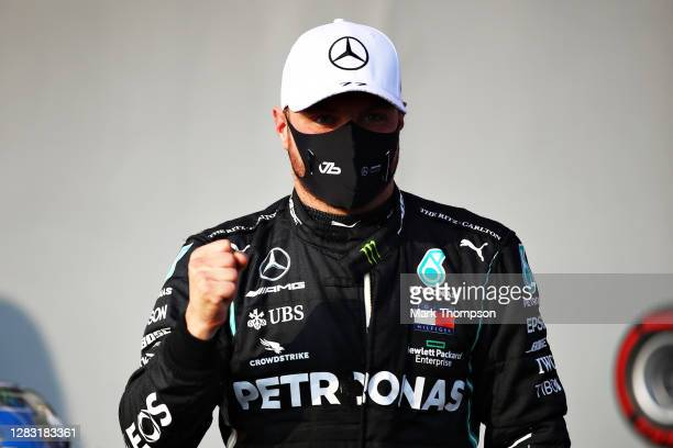 Pole position qualifier Valtteri Bottas of Finland and Mercedes GP celebrates in parc ferme during qualifying ahead of the F1 Grand Prix of Emilia...