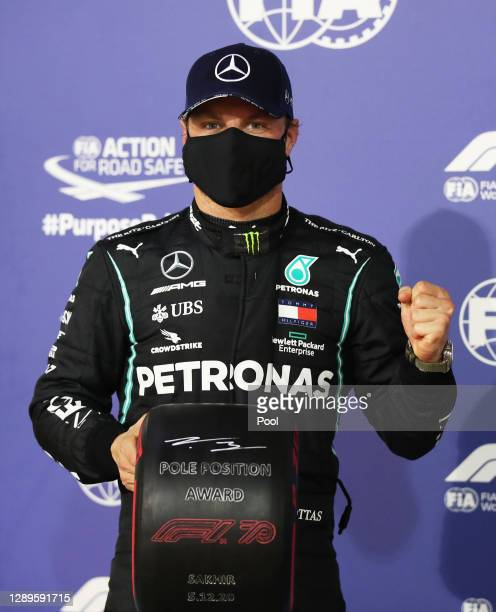 Pole position qualifier Valtteri Bottas of Finland and Mercedes GP celebrates with his pole position award in parc ferme during qualifying ahead of...