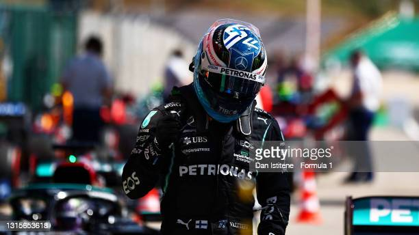 Pole position qualifier Valtteri Bottas of Finland and Mercedes GP celebrates in parc ferme during qualifying for the F1 Grand Prix of Portugal at...