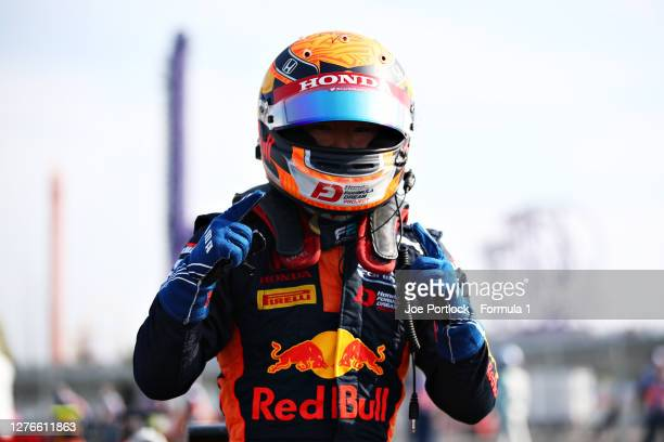 Pole position qualifier Yuki Tsunoda of Japan and Carlin celebrates in parc ferme during qualifying ahead of the Formula 2 Championship at Sochi...