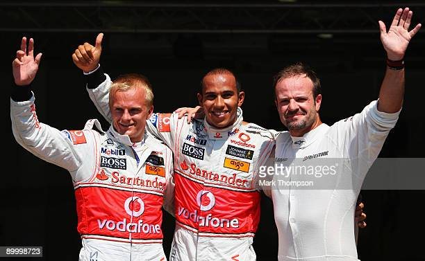 Pole position sitter Lewis Hamilton of Great Britain and McLaren Mercedes celebrates with in parc ferme with second placed Heikki Kovalainen of...