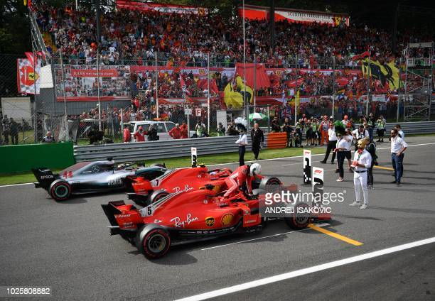 Pole position winner Ferrari's Finnish driver Kimi Raikkonen second placed Ferrari's German driver Sebastian Vettel and third placed Mercedes'...