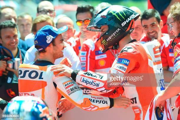 Pole position winner Repsol Honda Team's Spanish rider Dani Pedrosa is congratulated by second placed Ducati Team's Spanish rider Jorge Lorenzo after...