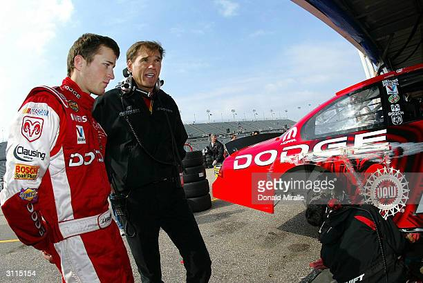 Pole Setter Kasey Kahne driver of the Dodge Dealers/UAW Dodge Intrepid speaks with team owner Ray Evernham after Kahne hit the wall during practice...