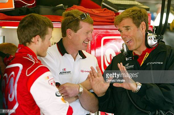 Pole Setter Kasey Kahne driver of the Dodge Dealers/UAW Dodge Intrepid speaks with Bill Elliott and team owner Ray Evernham during practice for the...