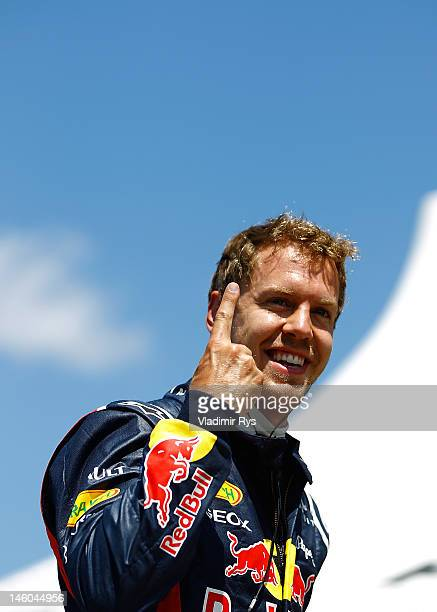 Pole setter Sebastian Vettel of Germany and Red Bull Racing celebrates after qualifying for the Canadian Formula One Grand Prix at the Circuit Gilles...