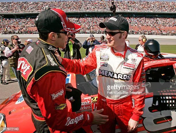 Pole sitter Aric Almirola talks with Dale Earnhardt Jr before the start of the NASCAR Busch Series Orbitz 300 at Daytona International Speedway in...