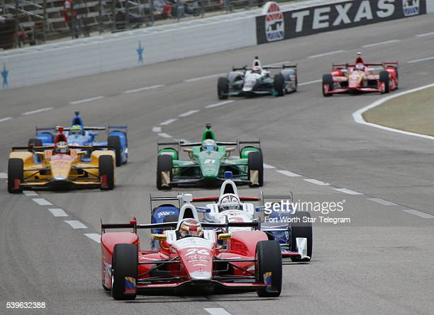 Pole sitter Carlos Munoz of Andretti Autosport leads early during the IndyCar Firestone 600 at Texas Motor Speedway in Fort Worth Texas on Sunday...