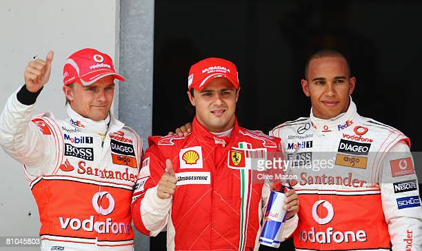 Pole sitter Felipe Massa of Brazil and Ferrari celebrates in parc ferme with third placed Lewis Hamilton of Great Britain and McLaren Mercedes and...