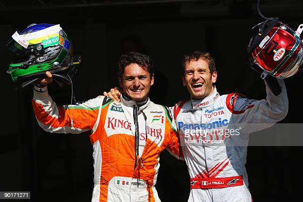 Pole sitter Giancarlo Fisichella of Italy and Force India celebrates with second placed Jarno Trulli of Italy and Toyota in parc ferme after...