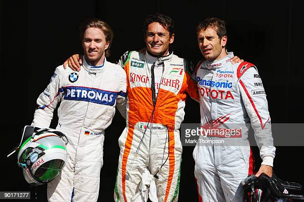 Pole sitter Giancarlo Fisichella of Italy and Force India celebrates with second placed Jarno Trulli of Italy and Toyota and third placed Nick...