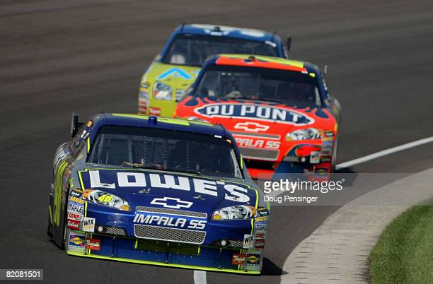 Pole sitter Jimmie Johnson leads the field in the Lowe's Chevrolet as he is chased by teammate Jeff Gordon in the DuPont Chevrolet and eventual...